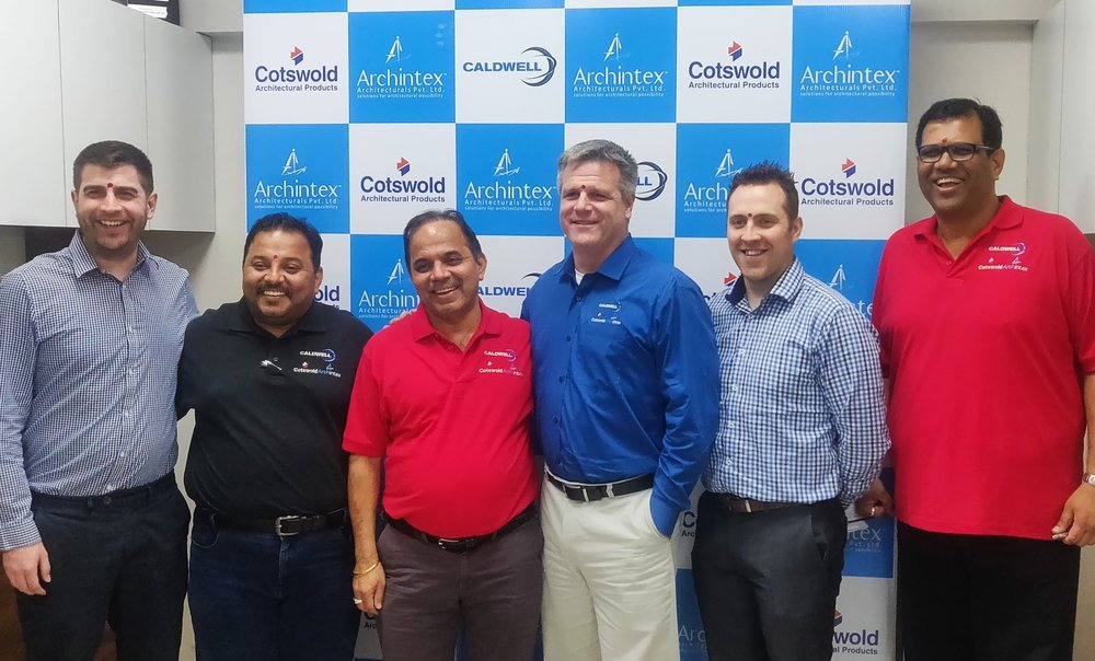 Eric Mertz and Tim Ferkin with the Archintex team following the acquisition