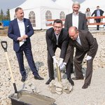 The first pillar is standing: Members of the board from D+H Mechatronic AG using a spade to begin laying the foundation for the new D+H Poland headquarters in Wroclaw.
