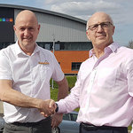 Paul Sowerby, Sales Director at GAP Ltd pictured with Steve Hacking, Operations Director at SupaLite, sealing the agreement to supply SupaLite Tiled Roof System through their network of over 100 GAP branches.